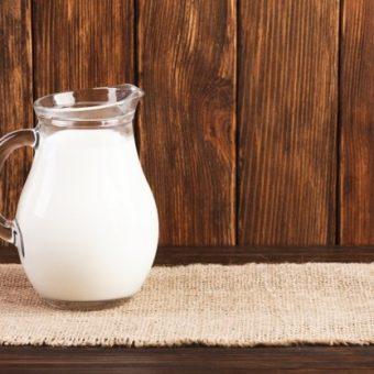jug-fresh-milk-wooden-table_23-2148239865